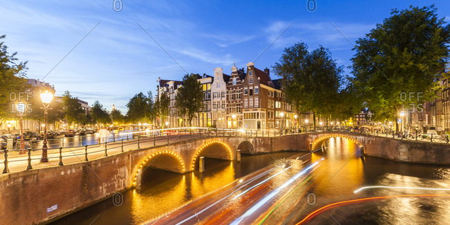 Netherlands- Amsterdam- lighted bridges over Emperor's Canal and Leidse Canal in the evening
