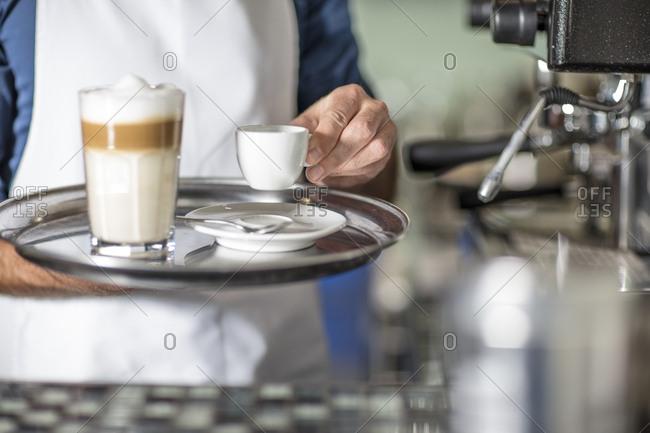 Barista serving Latte Macchiato