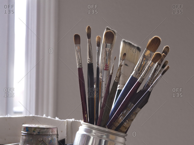Close up of paintbrushes in jar