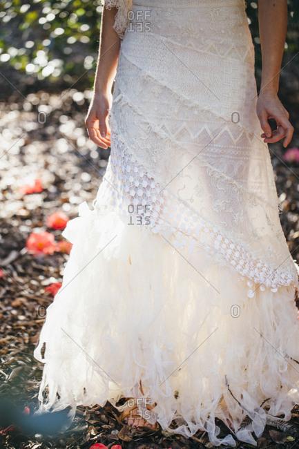 Bride wearing wedding gown in garden