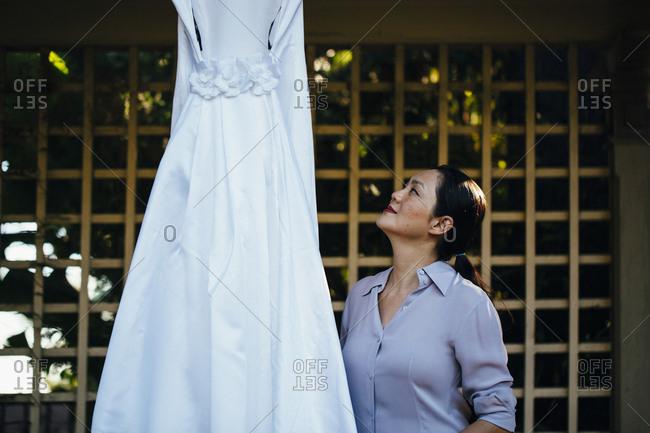 Korean bride admiring wedding dress