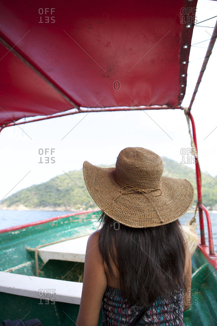 Woman wearing sun hat on ferry boat