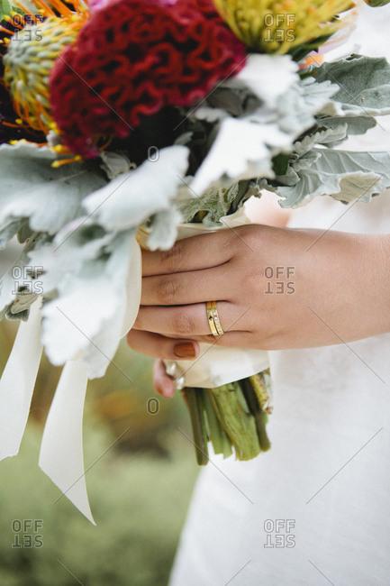 Close up of bride wearing wedding rings