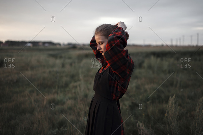 Caucasian woman standing in remote field