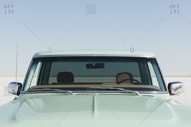 Detail  of a vintage Ford F100 pickup truck, the windshield and hood. Bonneville Salt Flats.