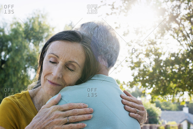 Senior couple hugging.