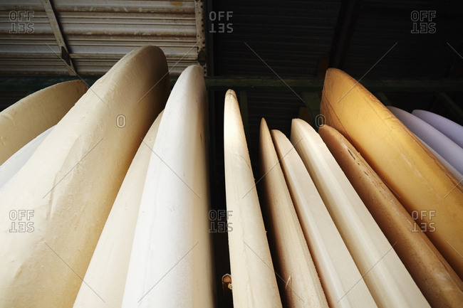 Close up of surfboards in store.