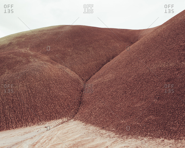 The red rocks of the Painted Desert landscape in the John Day Fossil Beds National Monument, Oregon.