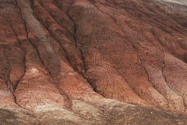 The landscape and geology of the John Day Fossil Beds National Monument, Oregon. Erosion of soil on the slopes of a hillside.