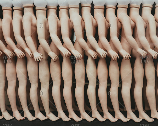 Row of female mannequins in a store window in Paris.