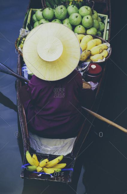 Damnoen Saduak Floating Market, a woman selling goods from boats in floating market
