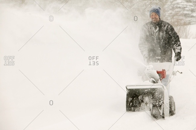 A Man Snow-Blowing - Offset Collection