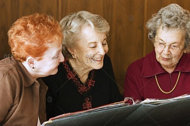 Seniors Reminiscing Over Photo Album