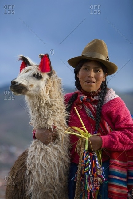 Cuzco, Peru; Peruvian Woman And Her Llama (Lama Glama)