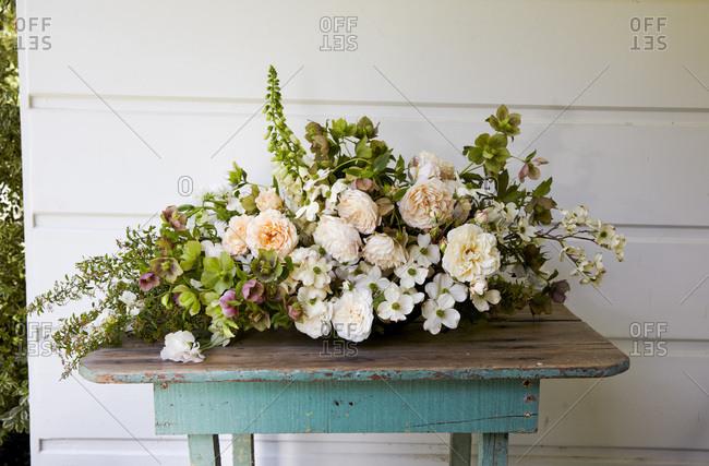 Large arrangement of spring flowers on blue table