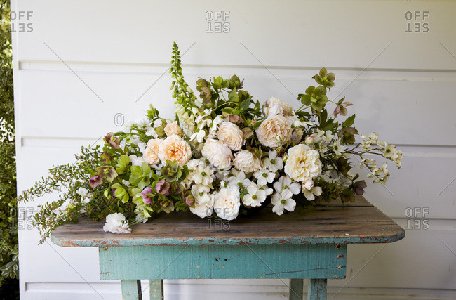 Large arrangement of spring flowers on blue table