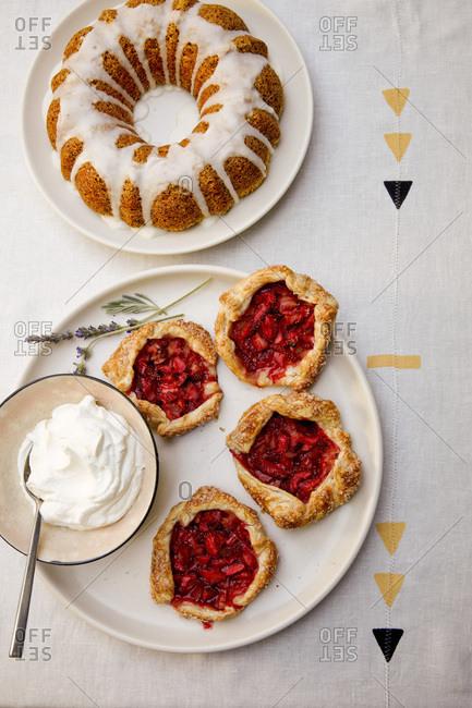 Bundt cake and strawberry rhubarb tarts on table