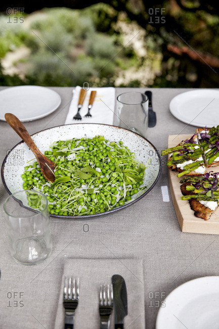 Spring pea and mint salad in large bowl on table