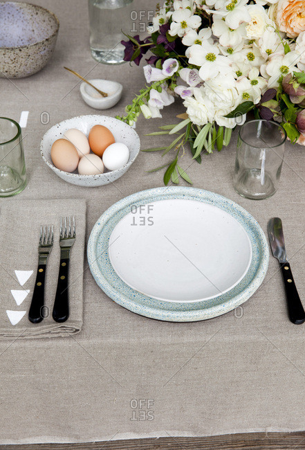 Table setting at outdoor table for Easter brunch