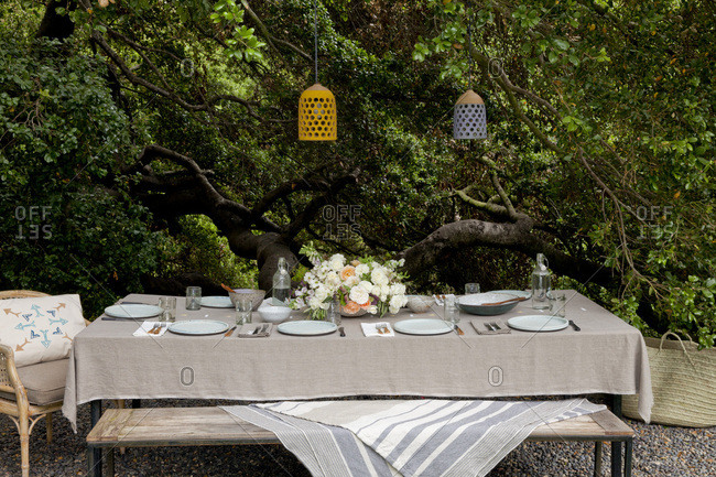 Long table set outdoors for Easter brunch