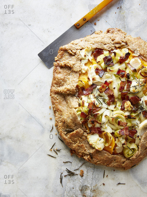 Bacon, leek and squash galette with knife