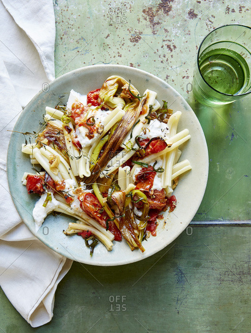 Serving roasted tomatoes and leeks over pasta