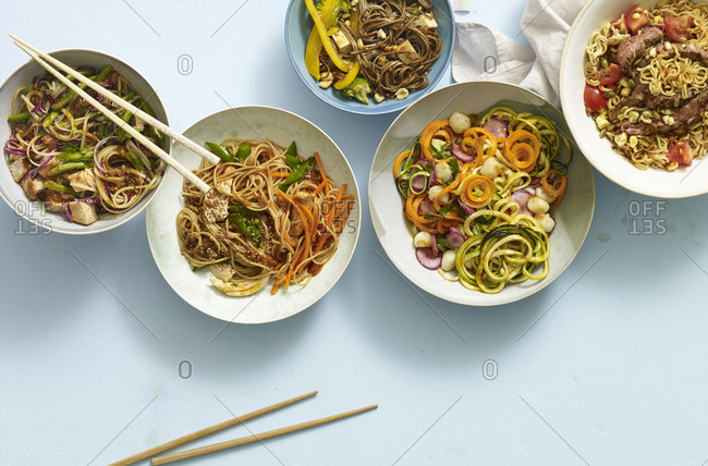 Overhead view of bowls of different noodle dishes