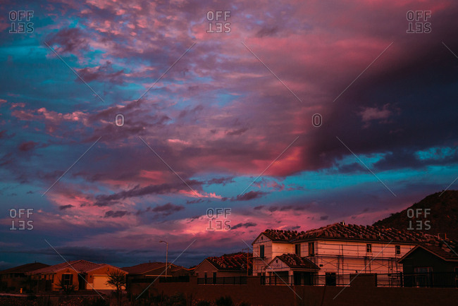 Colorful sunset and clouds over desert homes