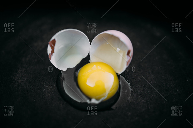 Egg cracked in a frying pan
