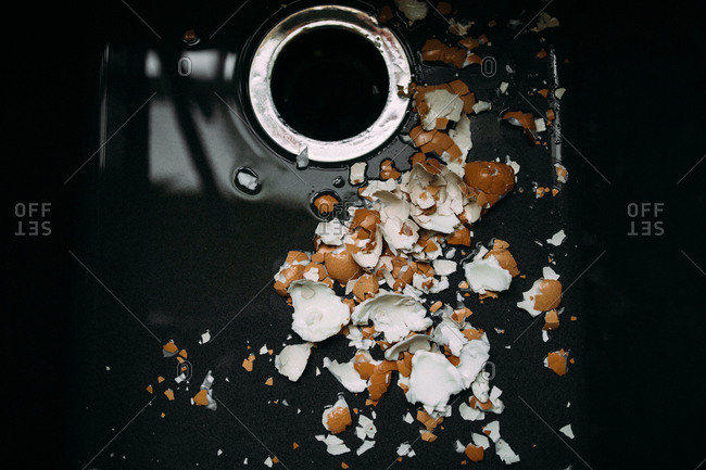 Cracked egg shells in a sink