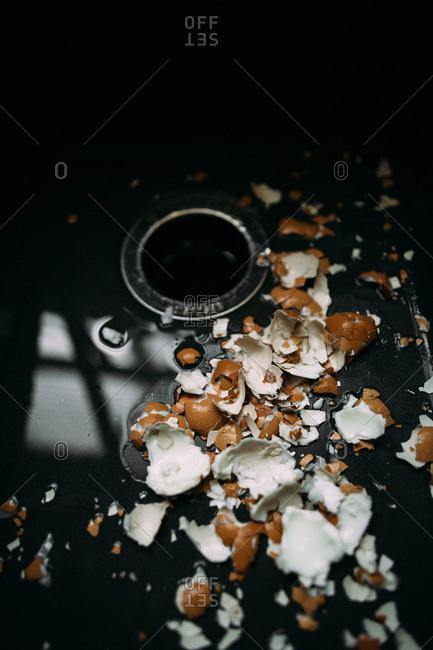 Broken egg shells in a sink