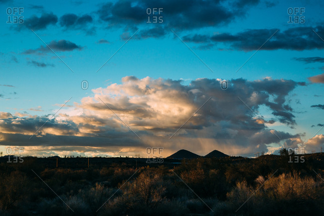 Cloudy sky over desert hills