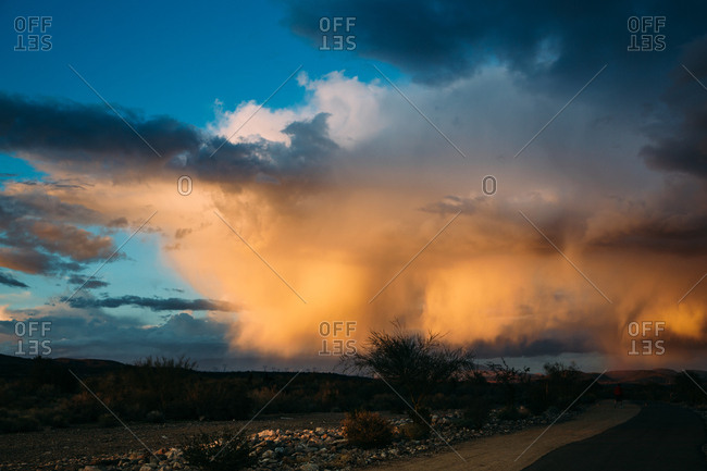 Clouds over desert road