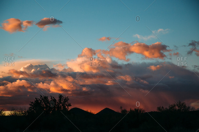 Clouds over desert mountains at sunset