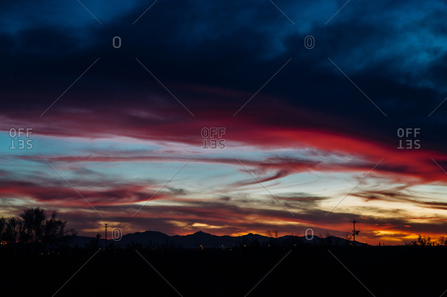 Colorful sunset over hilly desert landscape
