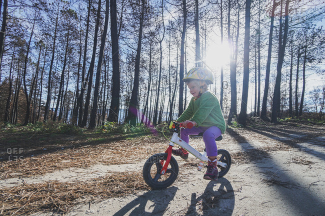 Little girl riding bike on a sunny day