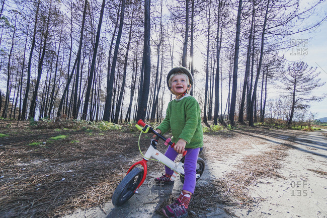 Young girl riding bike on a sunny day