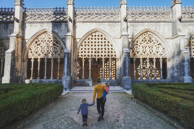 Mother walking with her daughters at the Batalha Monastery, Batalha, Portugal