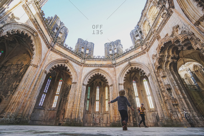 Mother and daughters in the Batalha Monastery, Batalha, Portugal