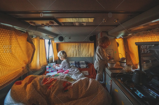 Girls playing in back of a campervan on a road trip
