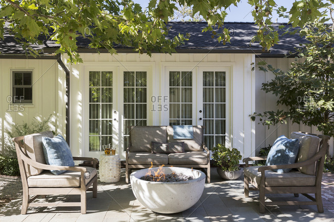 Patio with stone fire pit in the backyard of a Los Angeles home