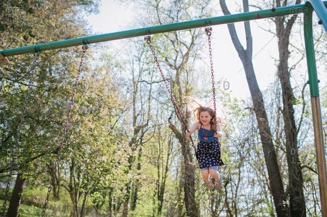 Girl having fun swinging