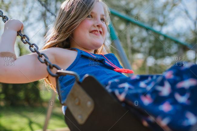 Girl smiling while swinging