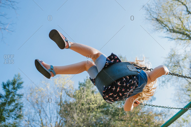 Low angle view of girl on swing