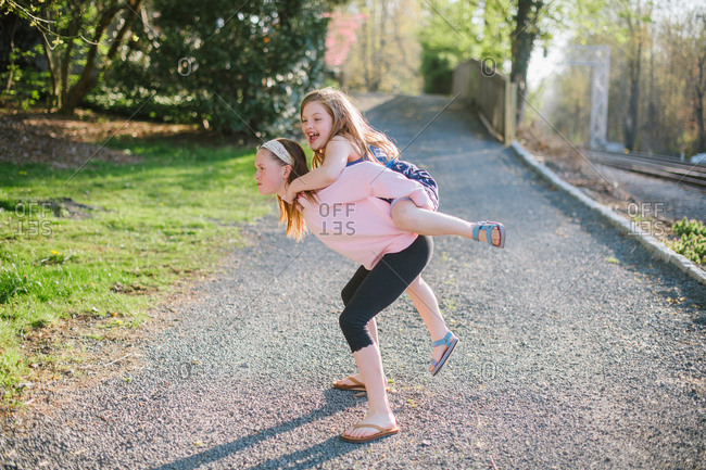 Girls playing on path by train track