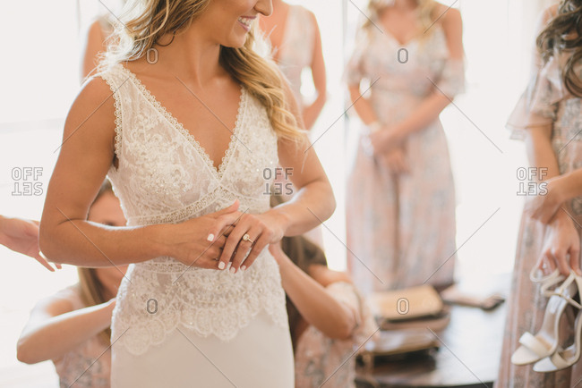 Bride and bridesmaids smiling together