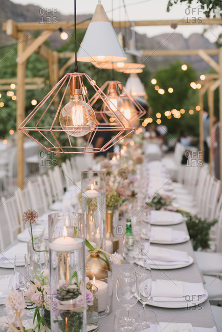 Light fixtures glowing over wedding table