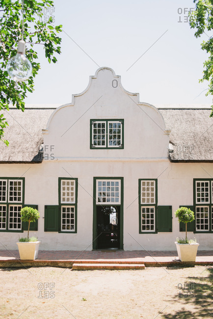 Front of white stucco building, South Africa