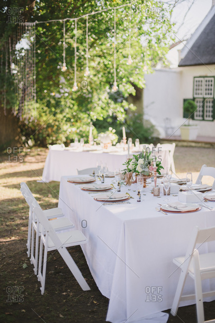 Wedding dinner tables in yard, South Africa
