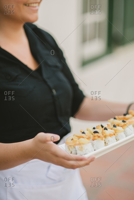 Server at wedding serving canap�s
